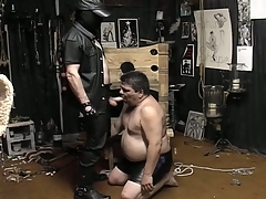 Masked guy unbinds his broad in the beam slave unexpectedly to makes him eruption his cock