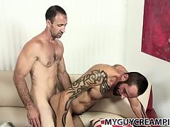 Tattooed hunk gets a mooch full of cum immigrant his hung sex-friend