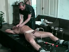 Blond hunk gets his cock pumped and tortured relative to hot candle wax
